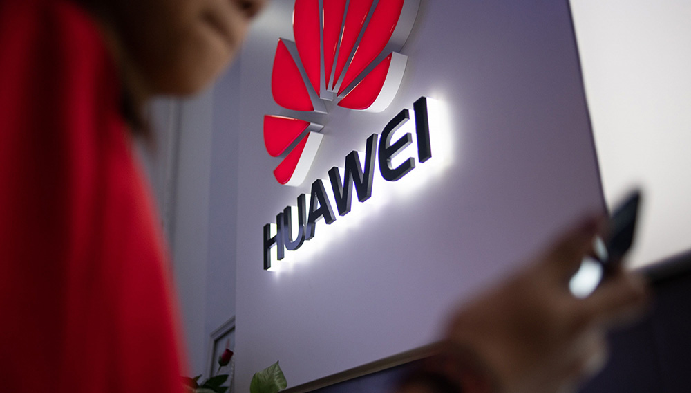 A Huawei logo is displayed at a retail store in Beijing in May. (Fred Dufour/AFP/Getty Images)