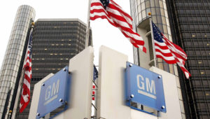 Signs stand in front of the General Motors world headquarters complex November 18, 2010 in Detroit, Michigan. GM returned to selling its newly issued stock to the public today as they resumed trading on the NYSE. The stock sales are expected to generate approximately $23 billion for General Motors. (Photo by Bill Pugliano/Getty Images)