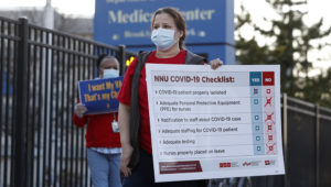 Members of the National Nurses Association, which includes registered nurses, outside the Brooklyn Veterans Administration Medical Center, Monday, April 6, 2020, in New York, where they called for more personal protective equipment (PPE) and staffing assistance to care for those affected by the current coronavirus outbreak. Photo: Kathy Willens