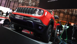"""A Jeep Renegade 4x4 e is presented at the Geneva Motor Show March 5, 2019. Signage in the background says""""'FCA Fiat Chrysler Automobiles,"""" to which Jeep belongs. Uli Deck   picture alliance   Getty Images"""