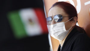 A woman wears a face mask to protect from the coronavirus disease (COVID-19) at Abraham Gonzalez International Airport, in Ciudad Juarez, Mexico March 14, 2020. REUTERS/Jose Luis Gonzalez
