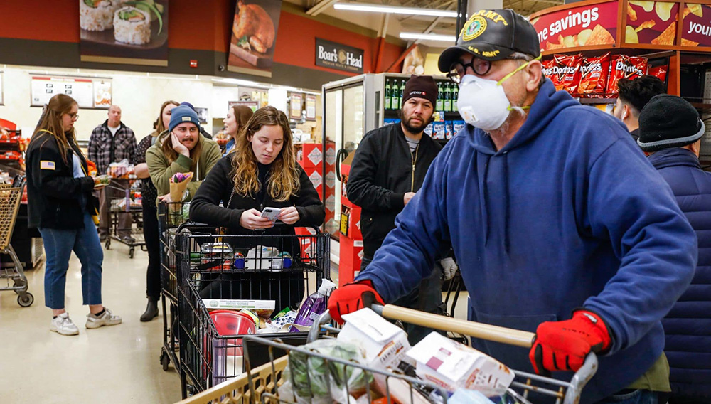 SAN FRANCISCO CA - MARCH 17: Mike Schwinn (right) and others wait In line to check out their purchases at the Safeway supermarket on 7th Avenue on Tuesday, March 17, 2020 in San Francisco, California. The city is in lockdown due to the coronavirus. (Gabrielle Lurie/The San Francisco Chronicle via Getty Images)