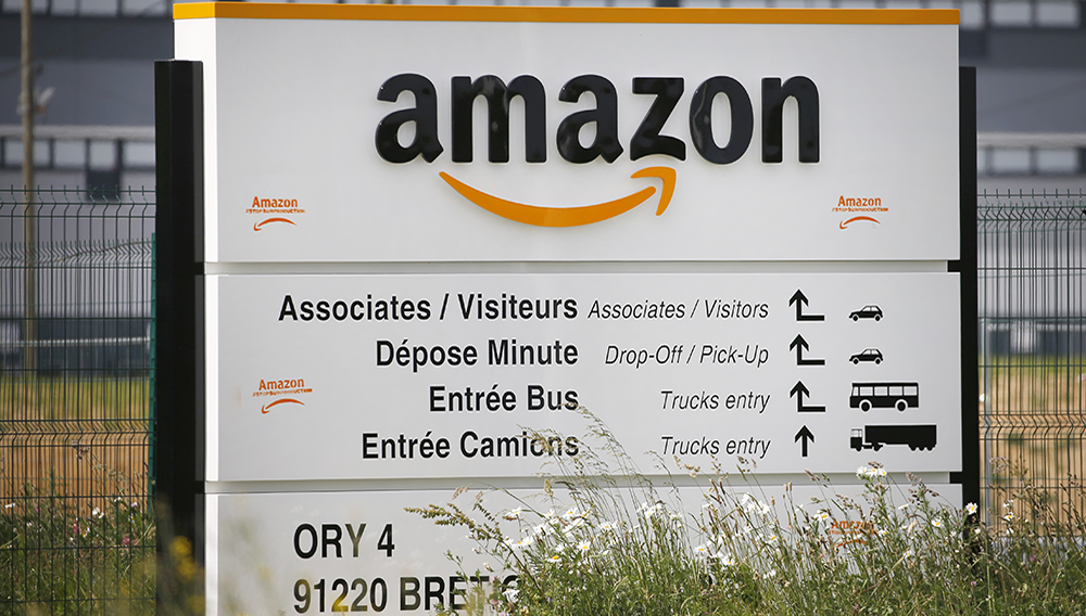 The logo of Amazon is seen at the entrance of the company logistics center on April 21, 2020 in Bretigny-sur-Orge, France. (Photo by Chesnot/Getty Images)
