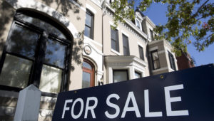 "A ""For Sale"" stands outside of a property in Washington, D.C., U.S., on Friday, oct. 17, 2014. The National Association of Realtors is scheduled to release existing home sales figures on oct. 21. Photographer: Andrew Harrer/Bloomberg via Getty Images"