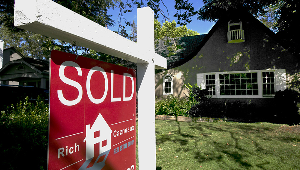 In this photo taken Wednesday, July 5, 2017 a sold sign is displayed in front of a house in Sacramento, California. (AP Photo/Rich Pedroncelli)