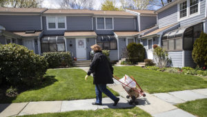 Georgette Penzavecchia delivers bags of groceries to seniors isolated in their homes on April 22, 2020 in Stamford, Connecticut. (Photo by John Moore/Getty Images)