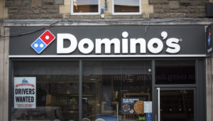 A branch of Domino's pizza takeaway is pictured on February 19, 2018 in Bath, England. (Photo by Matt Cardy/Getty Images)