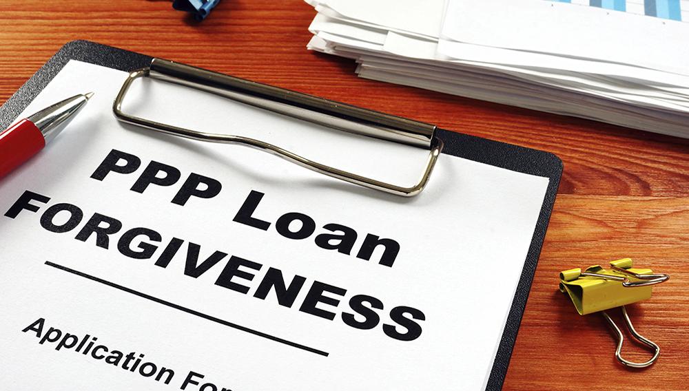 Paycheck Protection Program PPP Loan forgiveness application form. | Adobe Stock