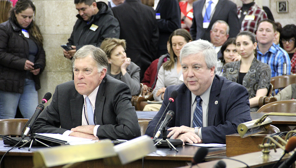 NJ Chamber President and CEO Tom Bracken and Senior Executive Vice President Michael Egenton urge legislators to take a common sense approach on minimum wage increases, as labor union members look on. Their testimony came during a State House Committee meeting on Jan. 24, 2019.