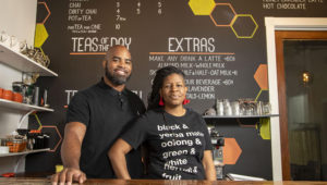 In this April 30, 2020 photo, Just Add Honey Tea Company owners Brandi and Jermail Shelton pose for a photo at their shop in Atlanta. They have switched their business focus to online orders during the COVID-19 pandemic. (Alyssa Pointer/Atlanta Journal-Constitution via AP)