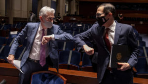 U.S. Federal Reserve chair Jerome Powell, left, and U.S. Treasury Secretary Steven Mnuchin bump elbows after a hearing of the House of Representatives financial services committee in Washington, D.C., on June 30, 2020. (Tasos Katopodis/Reuters)