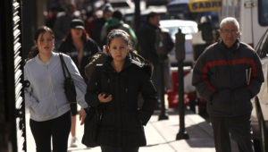 UNION CITY, NJ - MARCH 28: Hispanic residents walk down a street on March 28, 2011 in Union City, New Jersey. Union City New Jersey, one of the state's largest cities, has a population of Hispanic or Latino origin of over 80%. (Photo by Spencer Platt/Getty Images)