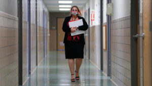 Jennifer Gottschalk, environmental health supervisor of the Toledo-Lucas County Health Department, walks down a hallway of the department's offices in Toledo, Ohio, on Wednesday, June 24, 2020. (AP Photo/Paul Sancya)