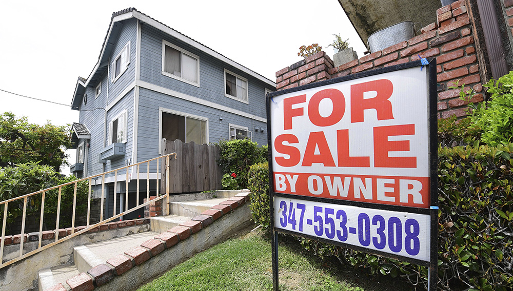 """A """"For Sale by Owner"""" sign is posted in front of property in Monterey Park, California on April 29, 2020. (Photo by FREDERIC J. BROWN/AFP via Getty Images)"""