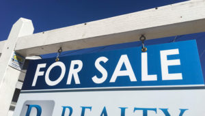 A 'For Sale' sign in front of a home in San Carlos in this undated photo.   PHOTO BY KPBS STAFF