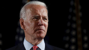 FILE PHOTO: Democratic U.S. presidential candidate and former Vice President Joe Biden speaks about responses to the COVID-19 coronavirus pandemic at an event in Wilmington, Delaware, U.S., March 12, 2020. REUTERS/Carlos Barria/File Photo