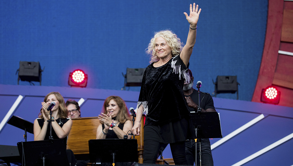 FILE - In this Sept. 28, 2019, file photo, Carole King waves to the crowd as she takes the stage at the 2019 Global Citizen Festival in New York. (AP Photo/Julius Constantine Motal, File)