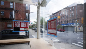 """In this May 12, 2020 photo, a storefront displays """"For Rent"""" signs in the window in the Red Hook neighborhood of the Brooklyn borough of New York. (AP Photo/Mark Lennihan)"""