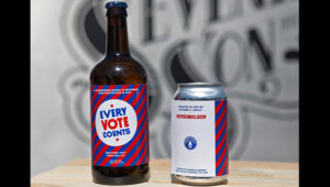 "This July 15, 2020 photo shows part of a campaign introduced by Ohio Secretary of State Frank LaRose for statewide voter registration awareness program called ""Raise a Glass to Democracy"" at Seventh Son Brewing in Columbus. Thirty Ohio breweries have signed up to create a beer using a universal label to designed to promote voter registration. The label has the VoteOhio.gov website printed on it. (Eric Albrecht/The Columbus Dispatch via AP)"