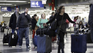 Travelers walk through Terminal 3 baggage claim at O'Hare International airport in Chicago on Dec. 1, 2013. | Nam Y. Huh, AP