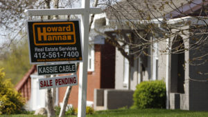 This Monday, April 27, 2020, file photo shows a sale pending sign on a home in Mount Lebanon, Pa. The coronavirus pandemic helped shape the housing market by influencing everything from the direction of mortgage rates to the inventory of homes on the market to the types of homes in demand and the desired locations. (AP Photo/Gene J. Puskar, File)