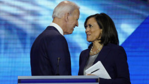 In this Sept. 12, 2019, photo, Democratic presidential candidate former Vice President Joe Biden, left, and then-candidate Sen. Kamala Harris, D-Calif. shake hands after a Democratic presidential primary debate hosted by ABC at Texas Southern University in Houston. Biden has chosen Harris as his running mate. (AP Photo/David J. Phillip)