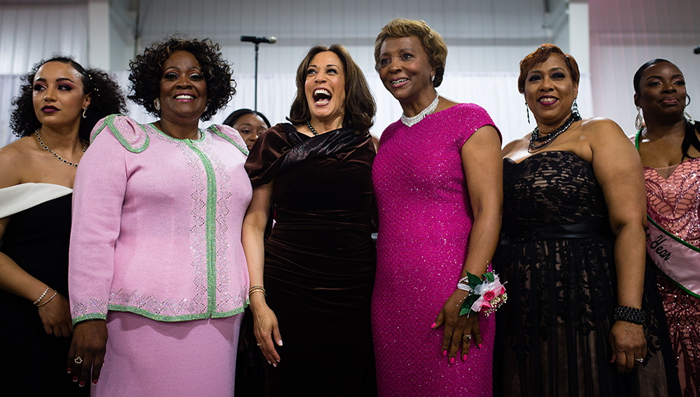 "Sen. Kamala D. Harris (D-Calif.), center, sings the Alpha Kappa Alpha hymn at the sorority's annual ""Pink Ice Gala"" on Jan. 25 in Columbia, S.C. (Elijah Nouvelage/Bloomberg News)"