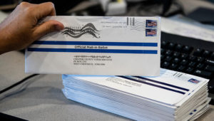 FILE - In this May 28, 2020, file photo, mail-in primary election ballots are processed at the Chester County Voter Services office in West Chester, Pa. (AP Photo/Matt Rourke, File)