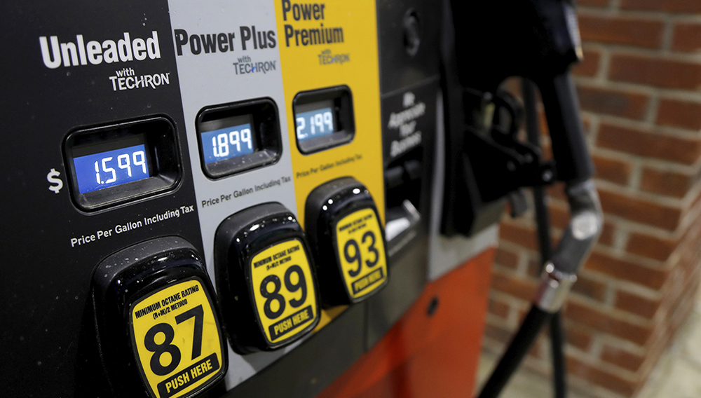 In this March 31, 2020 file photo, prices are seen on a gas pump in Brandon, Miss. U.S. consumer prices jumped 0.6% in July as gasoline prices continued to rise. The Labor Department reported Wednesday, Aug. 12, that the increase in its consumer price index matched a 0.6% rise in June. (AP Photo/Julio Cortez, File)