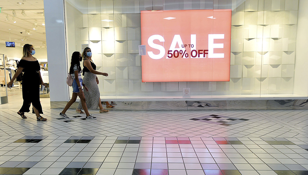 FILE - In this Aug. 11, 2020 file photo, shoppers walk through the Valley Mall in Halfway, Md. U.S. consumer confidence fell for second straight month in August as a resurgence of virus cases in many parts of the country heightened pessimism about the economy. (Colleen McGrath/The Herald-Mail via AP, File)