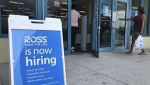 """In this July 8, 2020, file photo, a """"Now Hiring"""" sign sits outside a Ross Dress for Less store, in North Miami Beach, Fla. (AP Photo/Wilfredo Lee, File)"""