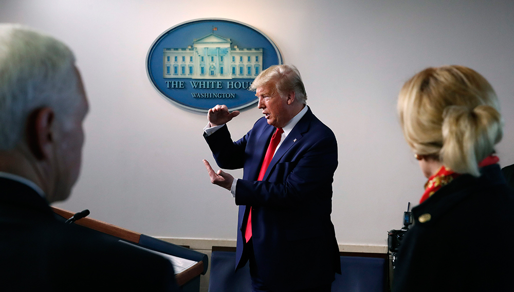 FILE - In this March 31, 2020, file photo President Donald Trump speaks about the coronavirus in the James Brady Press Briefing Room of the White House in Washington, as Vice President Mike Pence and Dr. Deborah Birx, White House coronavirus response coordinator, listen. (AP Photo/Alex Brandon, File)