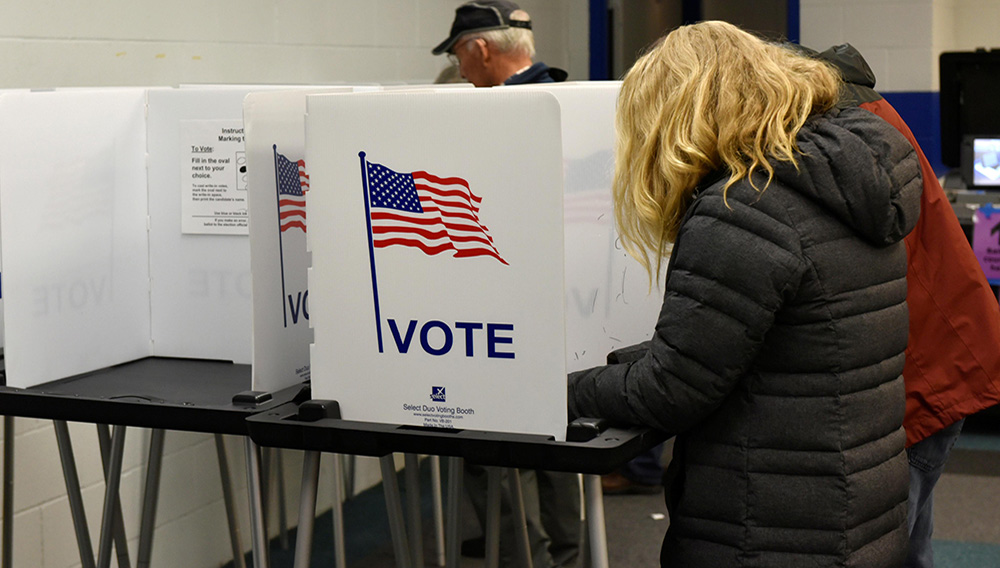 Voters fill out their ballots for the midterm election at a polling place in Madison, Wisconsin, U.S. November 6, 2018. REUTERS/Nick Oxford