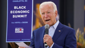 """Democratic U.S. presidential nominee Joe Biden speaks at an outdoor """"Black Economic Summit"""" while campaigning for president in Charlotte, North Carolina, U.S., September 23, 2020. REUTERS/Kevin Lamarque"""