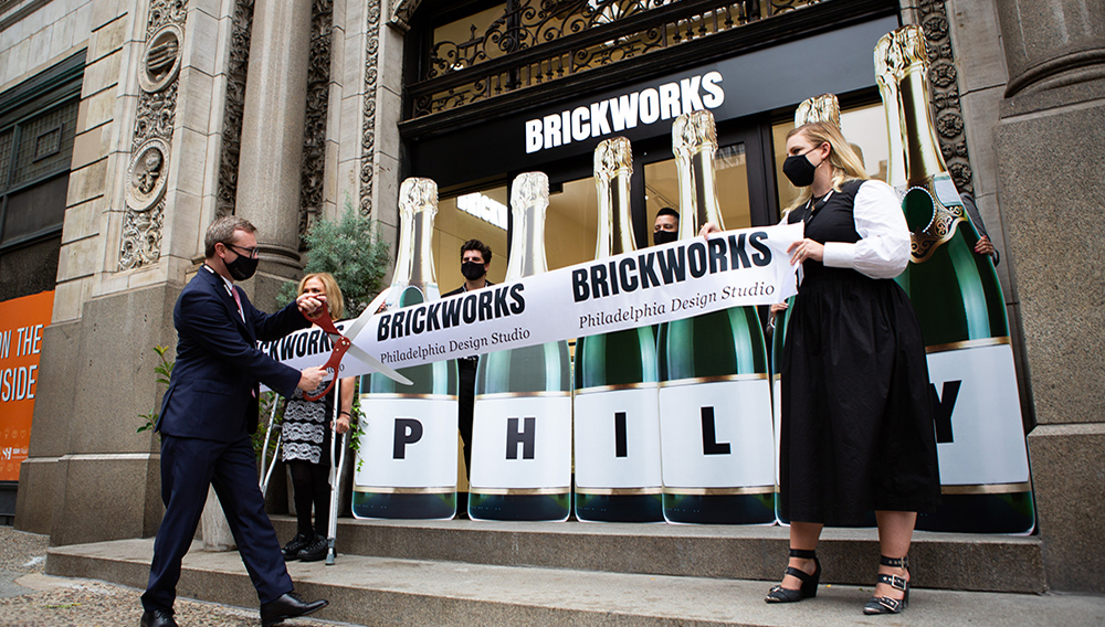 Mark Ellenor, President of Brickworks North America, cuts the ribbon at the official grand opening of the Brickworks Design Studio in Philadelphia.