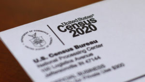 FILE - This Sunday, April 5, 2020, photo shows an envelope containing a 2020 census letter mailed to a U.S. resident in Detroit. (AP Photo/Paul Sancya, File)