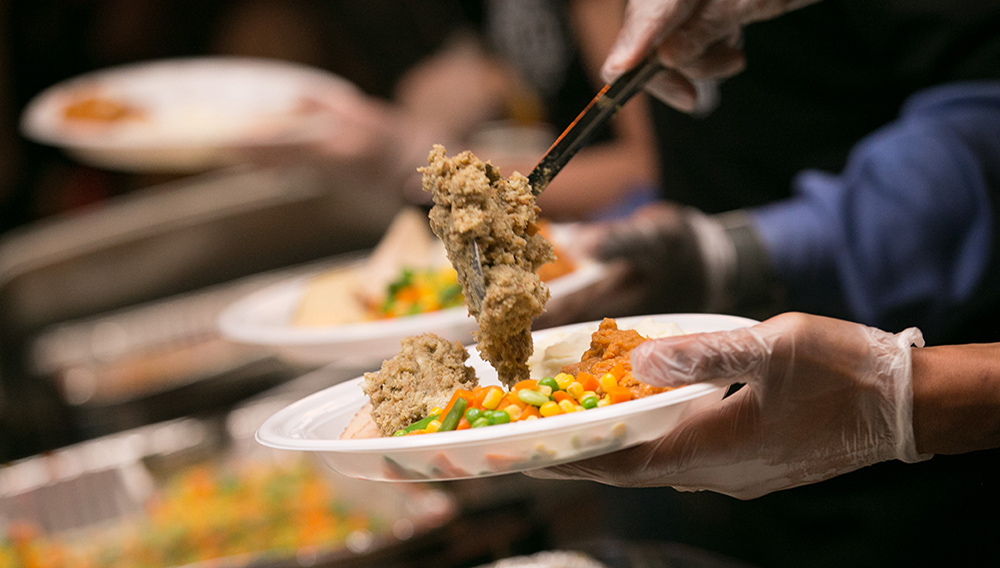 Stuffing is put onto a dinner plate Tuesday at Townhall restaurant in Cleveland, November 22, 2016, during their 4th annual Feed the Need event. | David Petkiewicz, cleveland.com