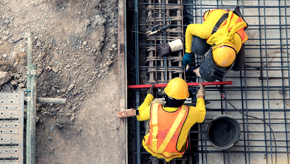 Aerial view construction worker site. | Shutterstock