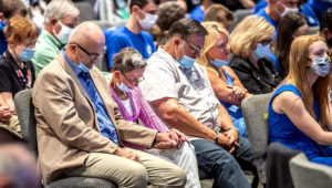 FILE—In this file photo from Sept. 9, 2020, people attending an event with Vice President Mike Pence, pray before he took the stage to speak to Marjorie Dannenfelser, president of the Susan B. Anthony List, an anti-abortion group, at Cornerstone Ministries church, in Export, Pa. a Pittsburgh suburb. (Alexandra Wimley/Pittsburgh Post-Gazette via AP, File)