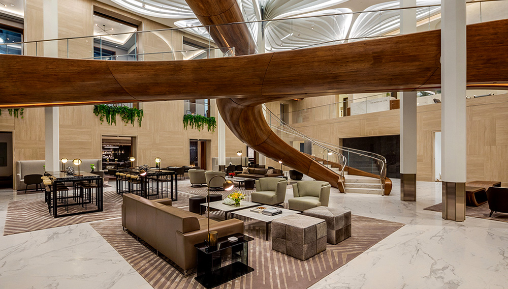 The centerpiece of the Waterline Club is Rockwell Group's dramatic three-level space that connects the club's 30 curated spaces with sculptural pedestrian bridges and a dramatic staircase that, in a nod to the development's waterfront location, was inspired by a boat's wooden hull and was crafted by Maine-based yacht builders, Hewes & Company and New York-based metal and glass fabrication firm, Jaroff Design.