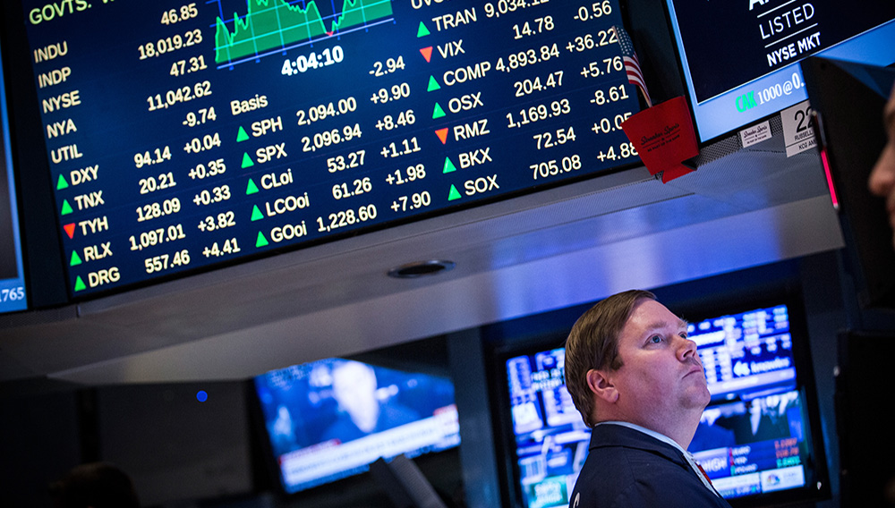 A trader works on the floor of the New York Stock Exchange during the afternoon of February 13, 2015 in New York City. (Photo by Andrew Burton/Getty Images)
