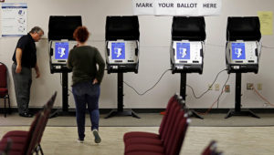 Electronic voting machines being tested in Conyers, Ga. The state has been the focal point for the debate over how closely election officials and the voting industry are intertwined. | David Goldman/AP
