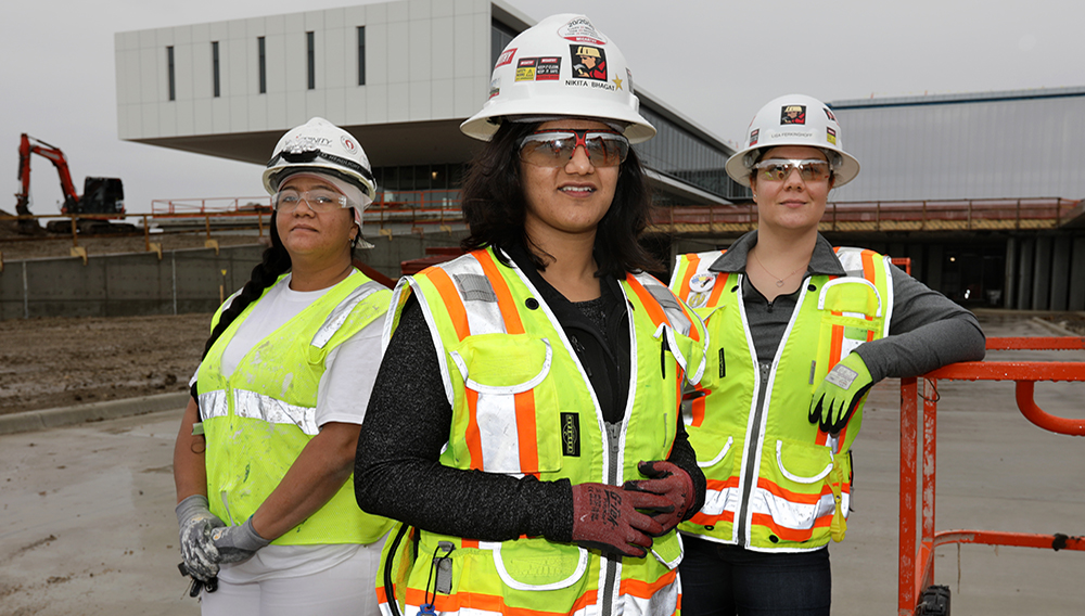 Karen Antunez, left, Nikita Bhagat, and Lisa Ferkinghoff are among the many women joining the construction industry. All three are working on the Collin College Technical Campus construction site in Allen. | Photo: Jason Janik
