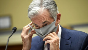 Federal Reserve Chair Jerome Powell takes off his face mask to testify during a House Select Subcommittee on the Coronavirus Crisis hearing on Capitol Hill in Washington on Wednesday, Sept. 23, 2020. (Kevin Dietsch/Pool via AP)