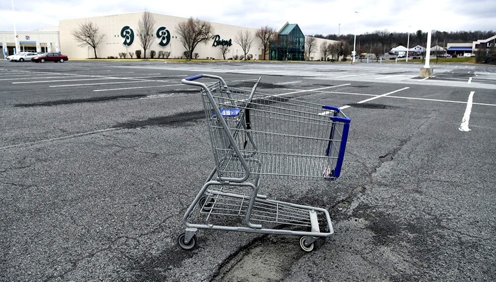 FILE - In this Tuesday, March 17, 2020 file photo, a lone shopping cart sits in an empty parking lot near a shopping mall closed due to coronavirus concerns in Pottsville, Pa. The temporary $300-a-week unemployment insurance boost implemented by President Donald Trump is about to end, with no extension in sight. The Federal Emergency Management Agency said Thursday, Sept. 10, 2020 in an email to The Associated Press that it has distributed $30 billion of the $44 billion it had set aside for the benefit. (Jacqueline Dormer/Republican-Herald via AP)