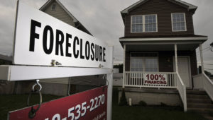 A foreclosure sign stands outside a home in Winchester, Virginia, U.S., on May 28, 2009. Photographer: Jay Mallin/Bloomberg News