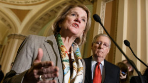 In this Jan. 20, 2015 photo, Sen. Shelley Moore Capito, R-W.Va., accompanied by Senate Majority Leader Mitch McConnell of Ky., speaks during a news conference on Capitol Hill in Washington. (AP Photo/J. Scott Applewhite, File)
