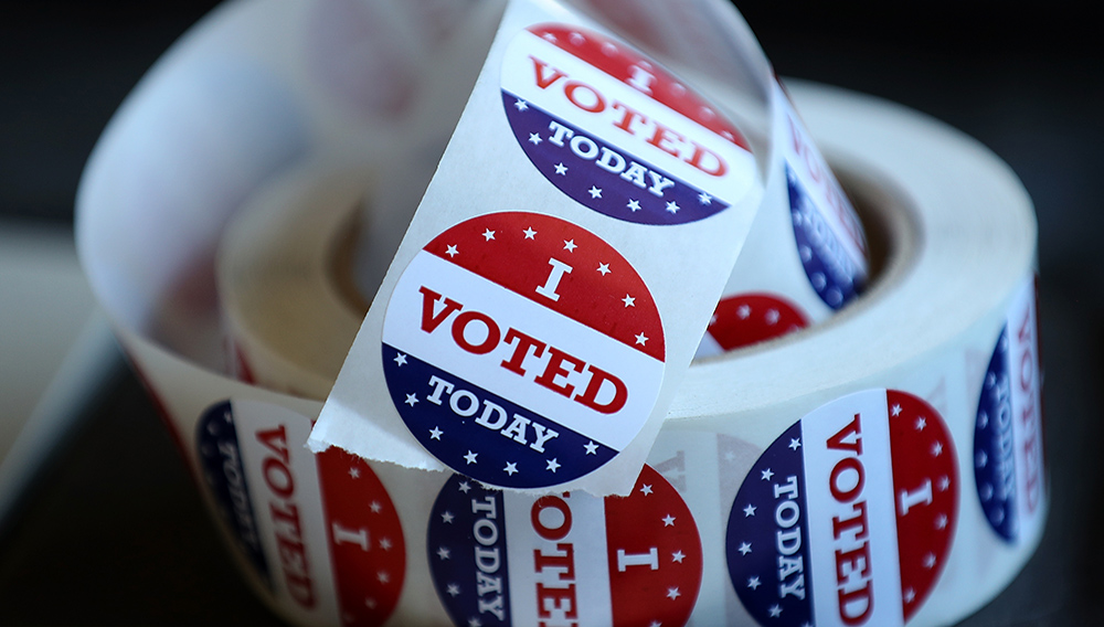 """SAN ANSELMO, CA - JUNE 05: A roll of """"I Voted"""" stickers sit on a table inside a polling station at a Ross Valley fire station on June 5, 2018 in San Anselmo, California. (Photo by Justin Sullivan/Getty Images)"""