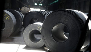 FILE - In this June 28, 2018, file photo, rolls of finished steel are seen at the U.S. Steel Granite City Works facility in Granite City, Ill. Companies seeking relief from President Donald Trump's taxes on imported steel and aluminum ran into long delays and cumbersome paperwork, a federal watchdog found, Wednesday, Sept. 16, 2020. (AP Photo/Jeff Roberson, File)