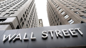 FILE - In this Aug. 31, 2020 file photo, buildings line Wall Street, in New York. Stocks are opening higher on Wall Street Thursday, Sept. 10 as the market claws back some more of the ground it lost in a three-day slump that snapped a day earlier. (AP Photo/Mark Lennihan, File)